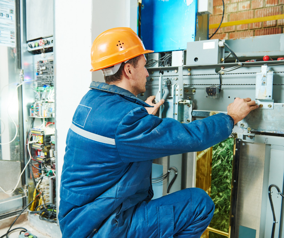 maintenance being performed on a commercial elevator